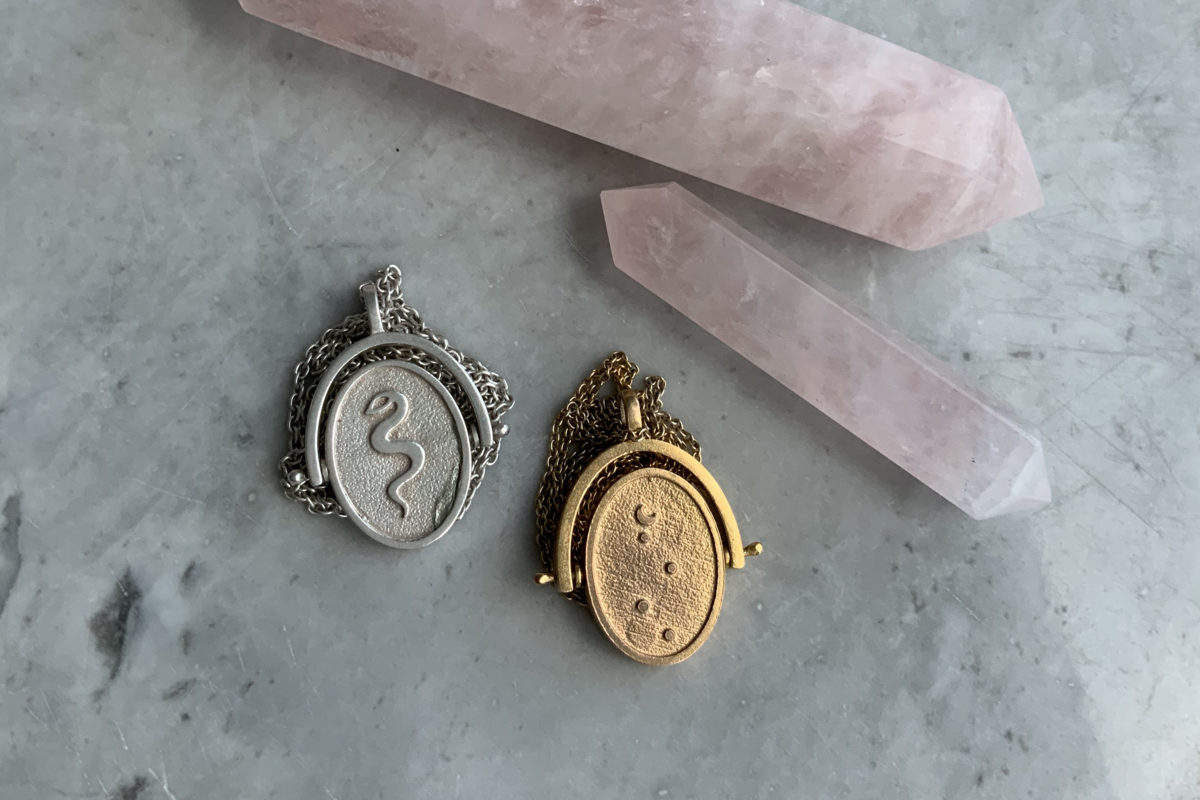 silver and gold spinning oracle necklaces with rose quartz points
